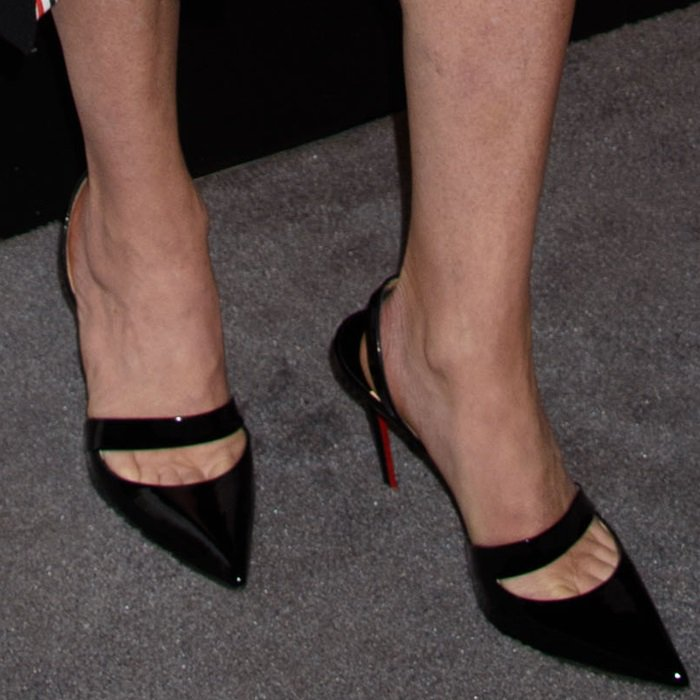"Julianna Margulies wearing Christian Louboutin's black patent pointy-toe ""Actina"" heels"