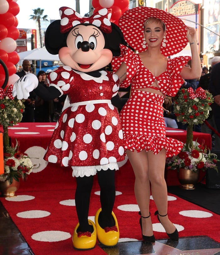 Katy Perry poses for some photos with Minnie Mouse at the Hollywood Walk of Fame ceremony celebrating the 90th anniversary of the Disney character