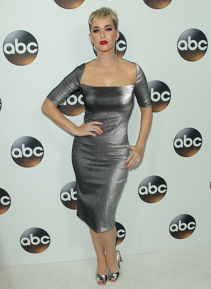 Katy Perry wearing Area's 'Clara' midi-dress with shimmering fabric that is jacquard-knit with a dot pattern