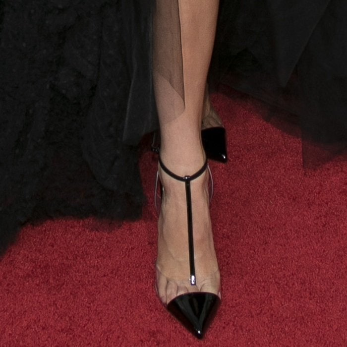 Kendall Jenner showing off her feet in Christian Louboutin's 'Nosy' pumps in patent leather and PVC