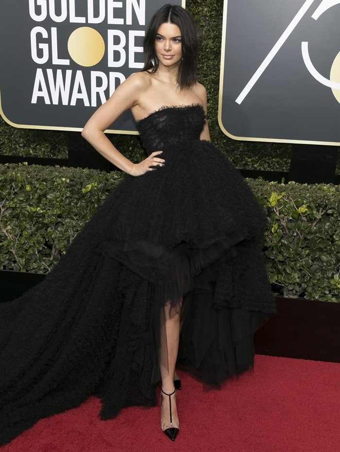 Kendall Jenner walked the red carpet at the Globes for the first time and kept with the all-black theme in a Giambattista Valli Fall 2017 Couture gown featuring a long, dramatic train and a shorter hemline in the front