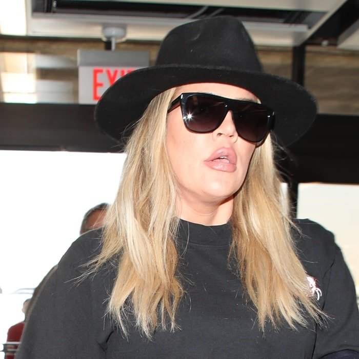 Khloe Kardashian with an open mouth shows off her super-sized lips