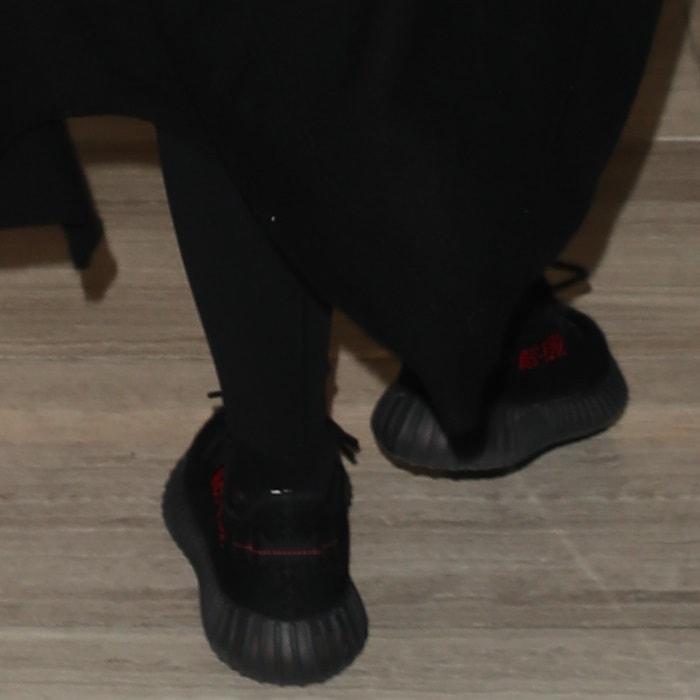 Khloe Kardashian wearing Kanye West's $1,000 primeknit Yeezy x Adidas Boost 350 V2 low-top sneakers