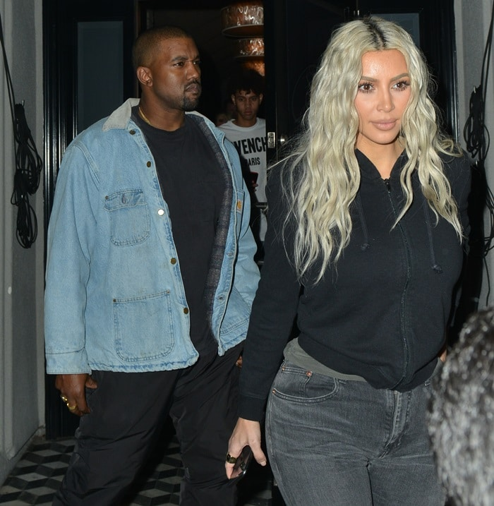 Kim Kardashian and Kanye West make their way out of Craig's restaurant in West Hollywood, California, on January 12, 2018