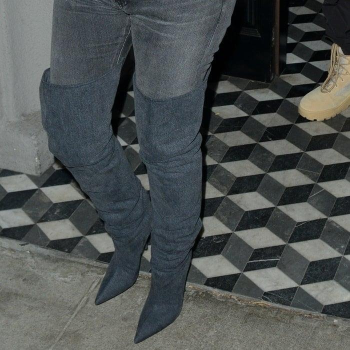 Kim Kardashian wearing pointy-toe Yeezy thigh high boots