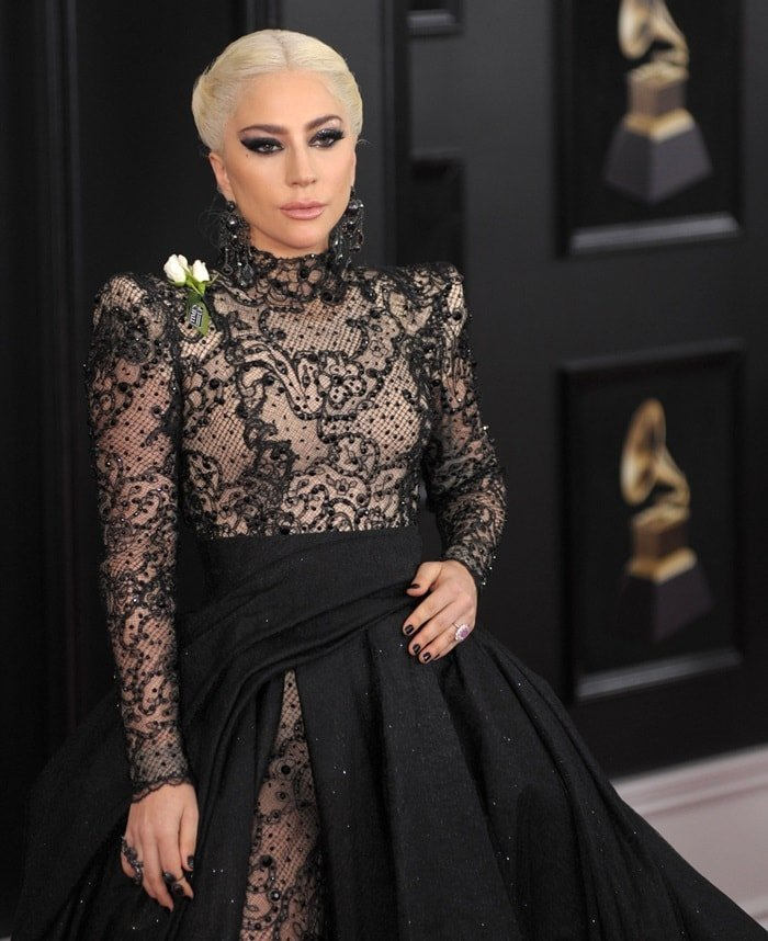Lady Gaga wore a white rose prominently on her shoulder to show her support for the Time's Up movement