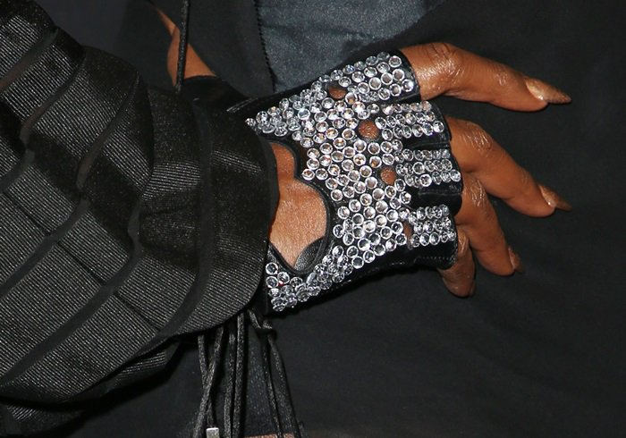 Laverne Cox showing off her diamond fingerless gloves inspired by Michael Jackson