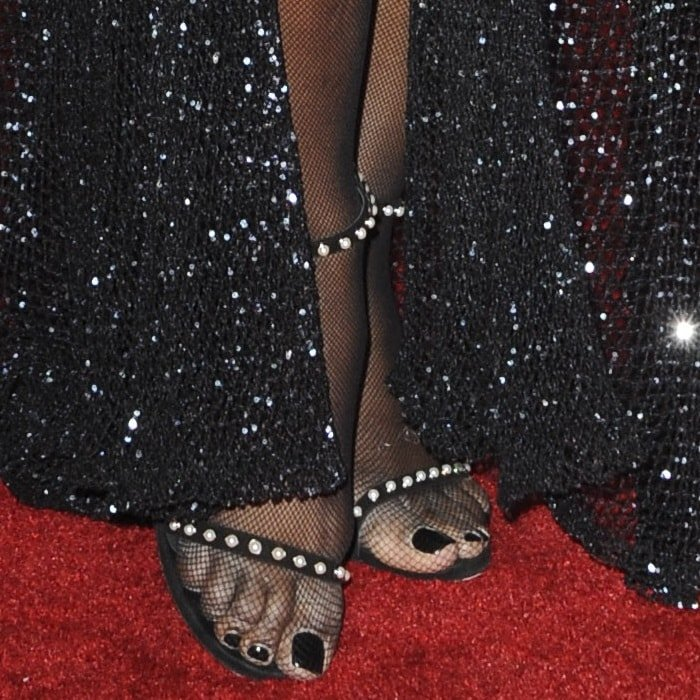 Laverne Cox showing off her feet in Stuart Weitzman shoes
