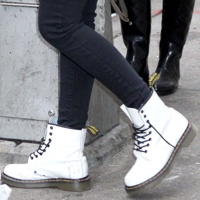 Madonna's daughter Lourdes Leon wearing untied white Dr. Martens boots while leaving the Manhattan Kabbalah Centre in New York City on January 8, 2011