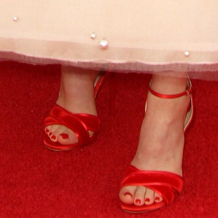 Madeline added a pop of color with velvet-satin Casadei sandals
