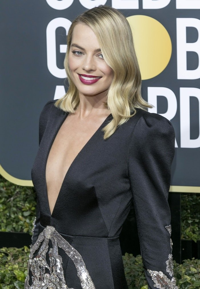 8267e7ad9ef Margot Robbie wearing a custom Gucci plunge gown at the 2018 Golden Globe  Awards held at