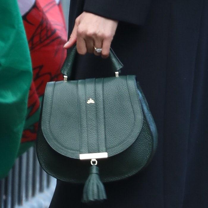 Meghan Markle toting an elegant DeMellier London 'Mini Venice' bag