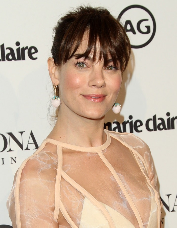 Michelle Monaghan showing off her gold, carved strawberry pink opal, turquoise and diamond pavé earrings from Irene Neuwirth