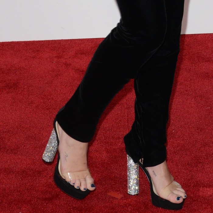 Miley Cyrus showing off her feet in crystal PVC sandals
