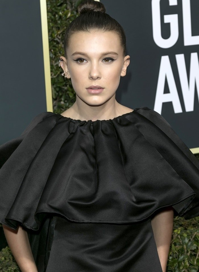 Millie Bobby Brown wearing Calvin Klein by Appointment at the 2018 Golden Globe Awards held at the Beverly Hilton Hotel in Beverly Hills, California, on January 7, 2018