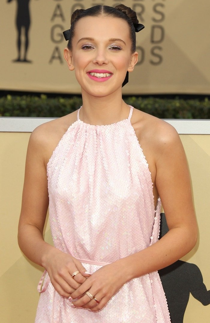 Millie Bobby Brown wearing a Calvin Klein By Appointment dress and Repossi jewelryon the red carpet at the 2018 Screen Actors Guild Awards at the Shrine Auditorium in Los Angeles on January 21, 2018