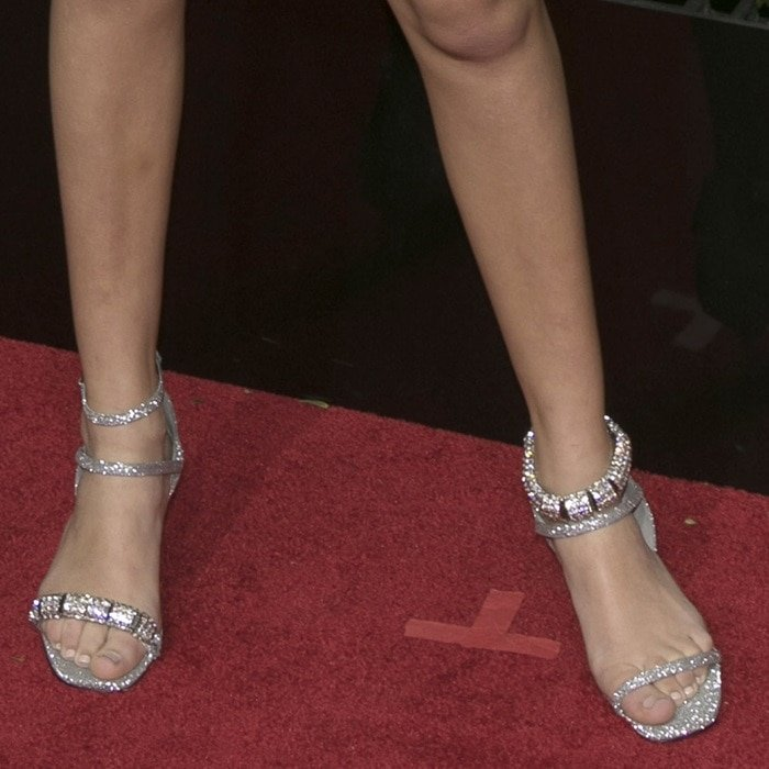 Millie Bobby Brown showing off her feet in glittering Calvin Klein kitten heels