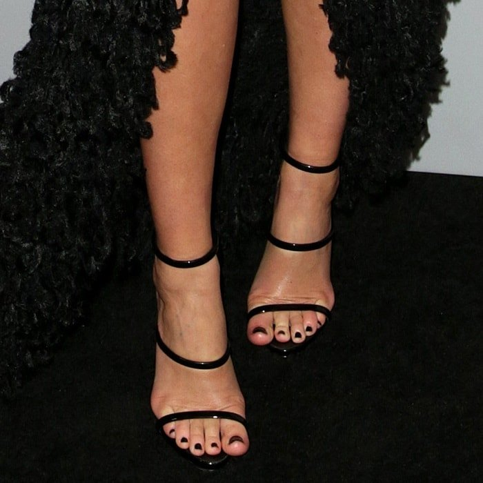 Miranda Kerr showing off her feet in Giuseppe Zanotti's black patent 'Harmony' leather sandals