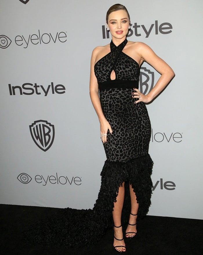 Miranda Kerr wearing a leopard-print halter Balmain dress at the 2018 Golden Globe Awards held at the Beverly Hilton Hotel in Beverly Hills, California, on January 7, 2018