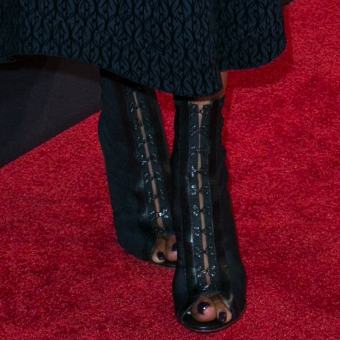 Naomi Campbell showing off her feet in peep-toe Azzedine Alaïa booties