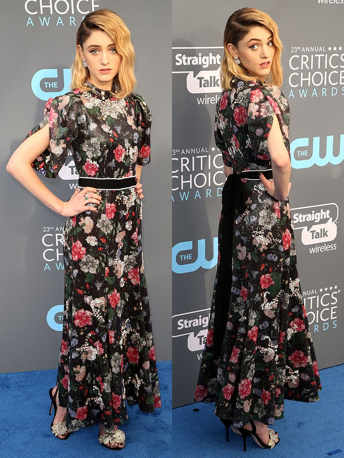 Natalia Dyer wearing a crystal-overlaid Erdem Spring 2018 floral-print tulip-sleeve dress at the 2018 Critics' Choice Awards held at the The Barker Hangar in Santa Monica, California, on January 11, 2018.