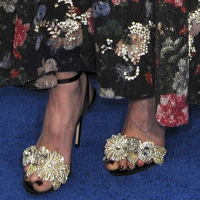 Closeup of the Sophia Webster 'Lilico' sandals on Natalia Dyer's feet.