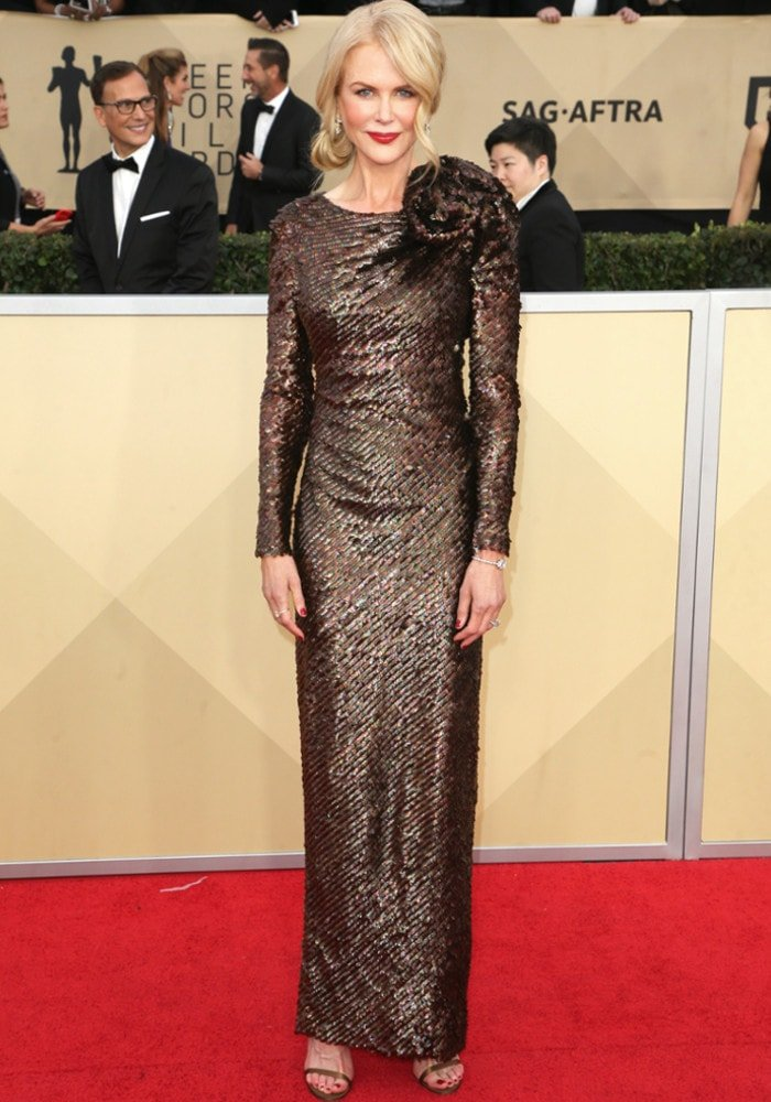 Understated yet elegant: Nicole steps on the red carpet in an Armani Privé dress