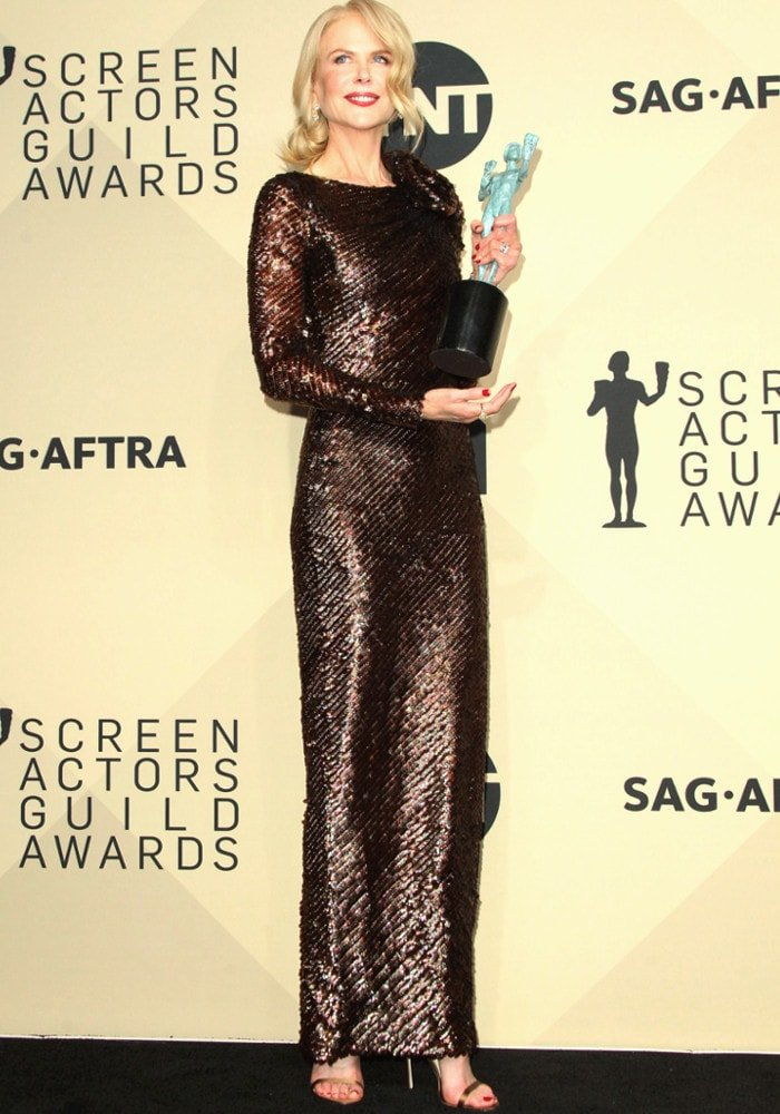 Nicole beams as she holds on to her first SAG trophy
