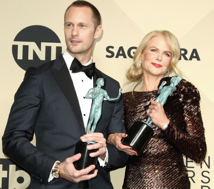 Double win: Nicole cuddles up to her onscreen husband Alex Skarsgard