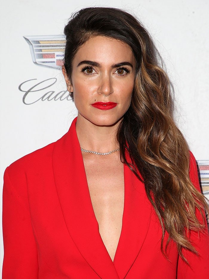 Nikki Reed wore her hair in a sideswept and slicked-down style that perfectly showed off her diamond earrings and the exquisite gold-and-diamond necklace at her collarbone