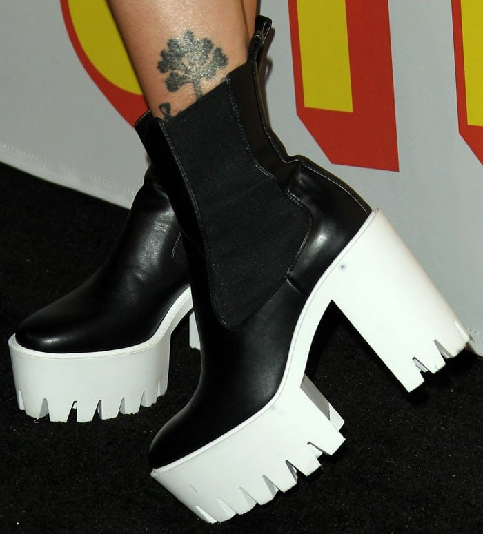 Paris Jackson wearing Stella McCartney 'Monster' faux-leather chelsea boots with chunky white rubber platform soles.