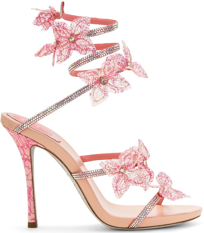 Pink satin sandal with a slender strap and snake wrapping around the ankle