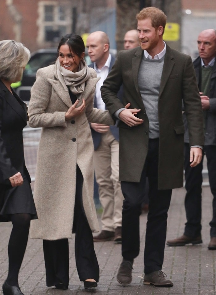 While Prince Harry wore a Club Monaco wool topcoat, the 36-year-old former actress and future royal wore a Smythe coat