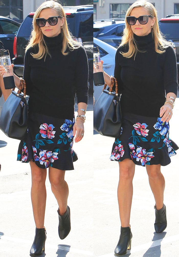 "Reese brightens up her outfit with the ""Dorothy"" floral skirt from her brand Draper James"