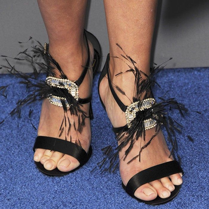 "Reese wore the head-turning Roger Vivier ""Sin"" sandals"