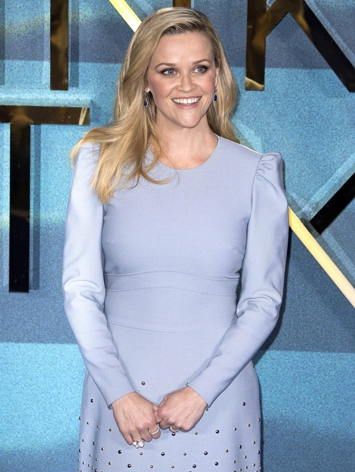 Reese Witherspoon'sflattering dress from Elie Saab's Pre-Fall 2018 collection featuring long sleeves with a poof shoulder, scalloped embellishment along skirt, and a crew neckline