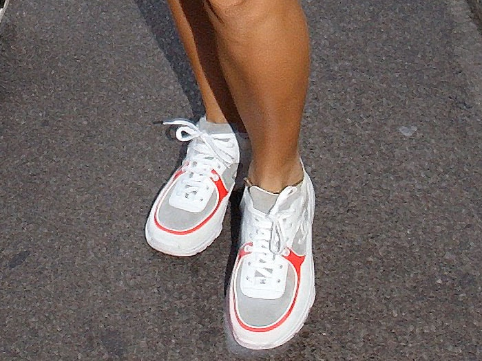 Rita Ora embracing the dad sneaker trend in white-and-orange Chanel spring 2018 sneakers