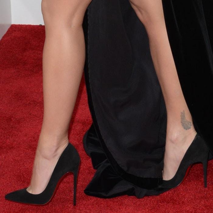 Rita Ora wearing pointy-toe Christian Louboutin pumps