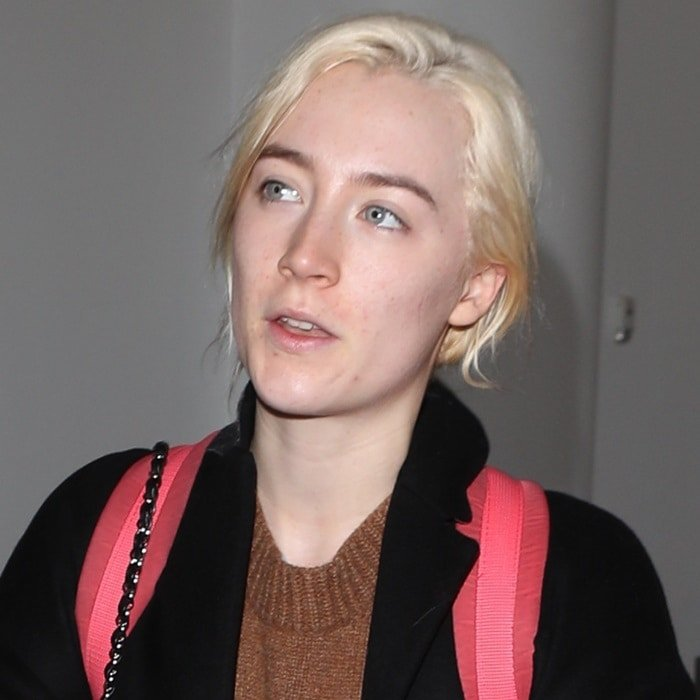 Make-up free Saoirse Ronan arrives at Los Angeles International Airport (LAX) on January 11, 2018