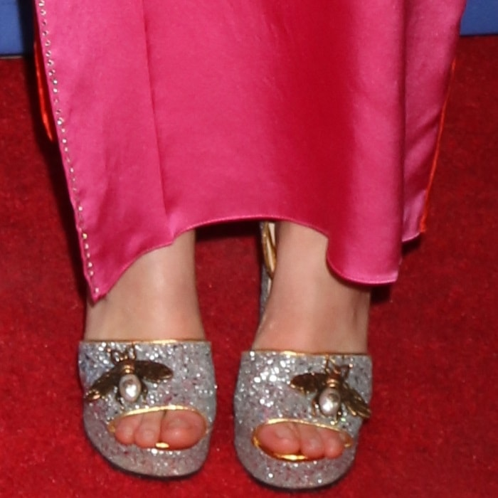Saoirse Ronan showing off her feet in silver pumps from Gucci embellished with polished bee motifs