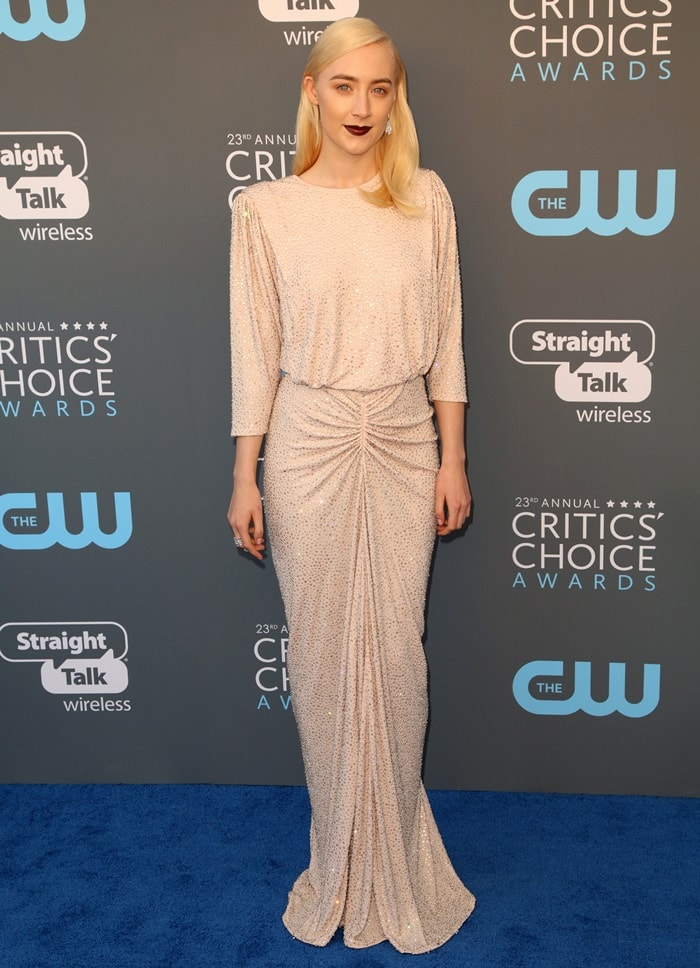 Saoirse Ronan wearing a silver crystal-embroidered gown by Michael Kors featuring a fitted skirt and a loose top at the 2018 Critics' Choice Awards at The Barker Hangar in Santa Monica, California, on January 11, 2018