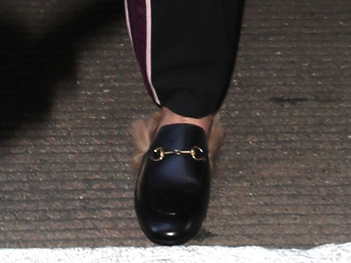 Sharon Stone's choice of footwear for travel: the Gucci 'Princetown' fur-trimmed leather slippers.