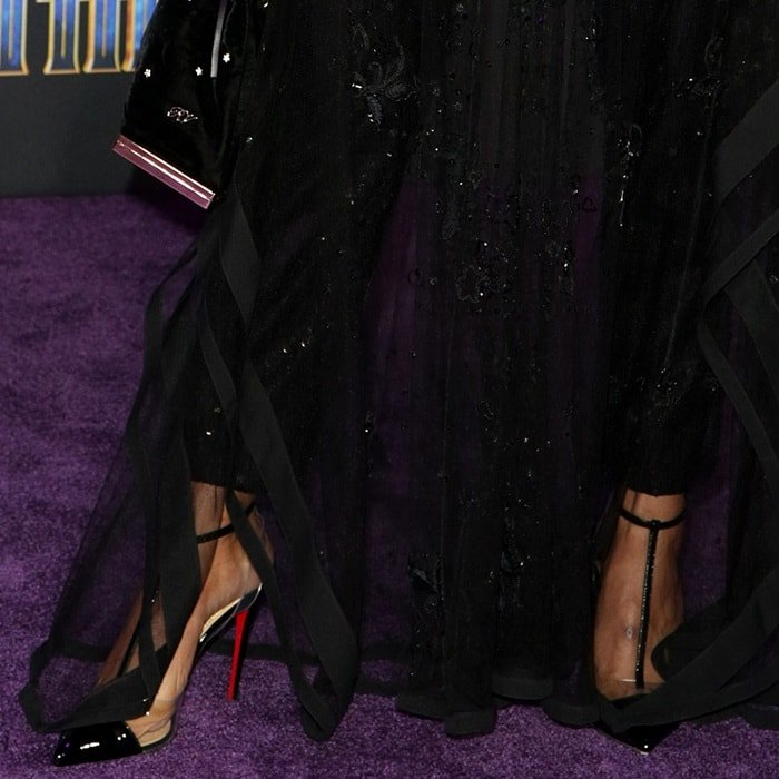 Tessa Thompson wearing Christian Louboutin's 'Nosy' pumps in patent leather and PVC