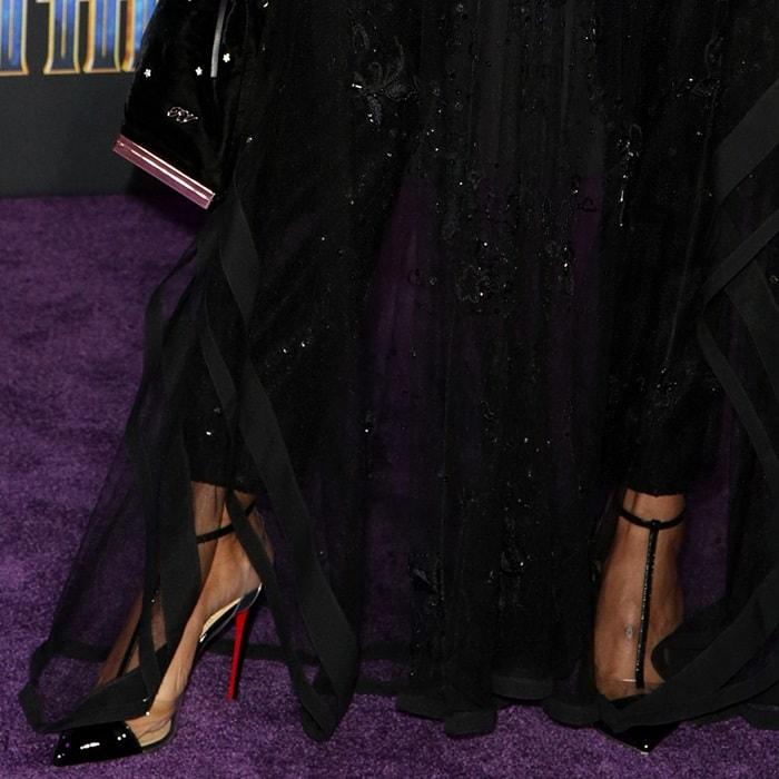 68818c1a14af Tessa Thompson wearing Christian Louboutin s  Nosy  pumps in patent leather  and PVC