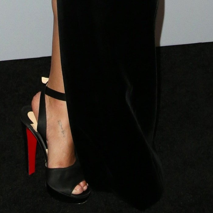 Zoë Kravitz showing off her feet in black suede Christian Louboutin 'Louloudancing' heels