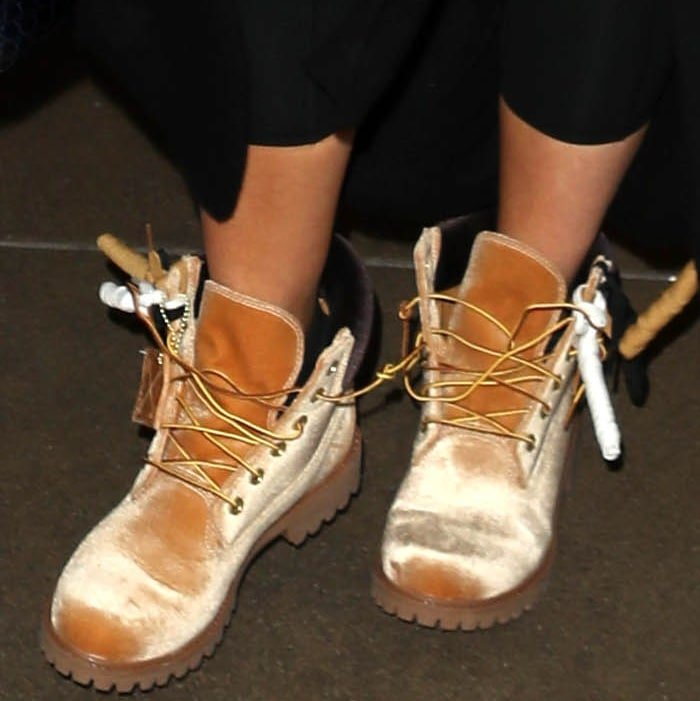 Khloe Kardashian wearing Timberland x Off-White leather lace-up boots at the Los Angeles International Airport
