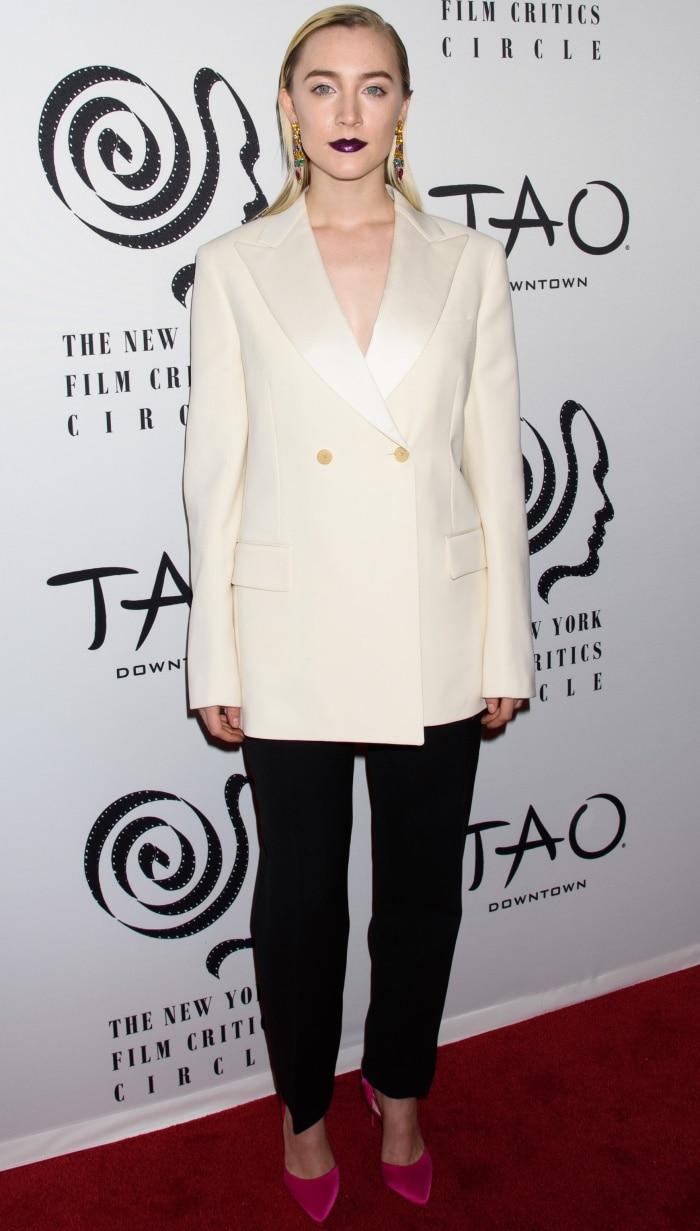 "Saoirse Ronan wearing a Calvin Klein ensemble and Christian Louboutin ""Douce du Desert"" pumps at the 2018 New York Film Critics Circle Awards"