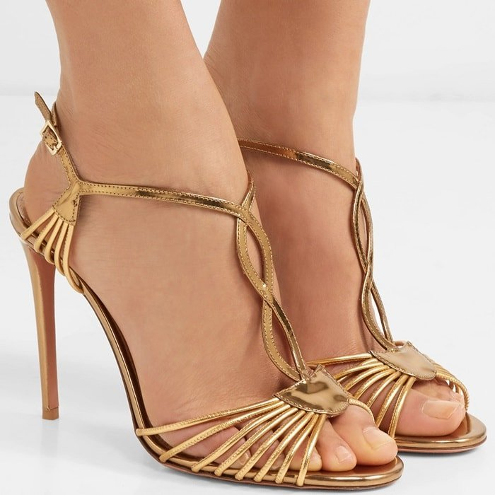 Inspired by shoes from the '20s, these nappa laminated leather sandals in antique gold features flattering and slim straps at the toe and around the ankle