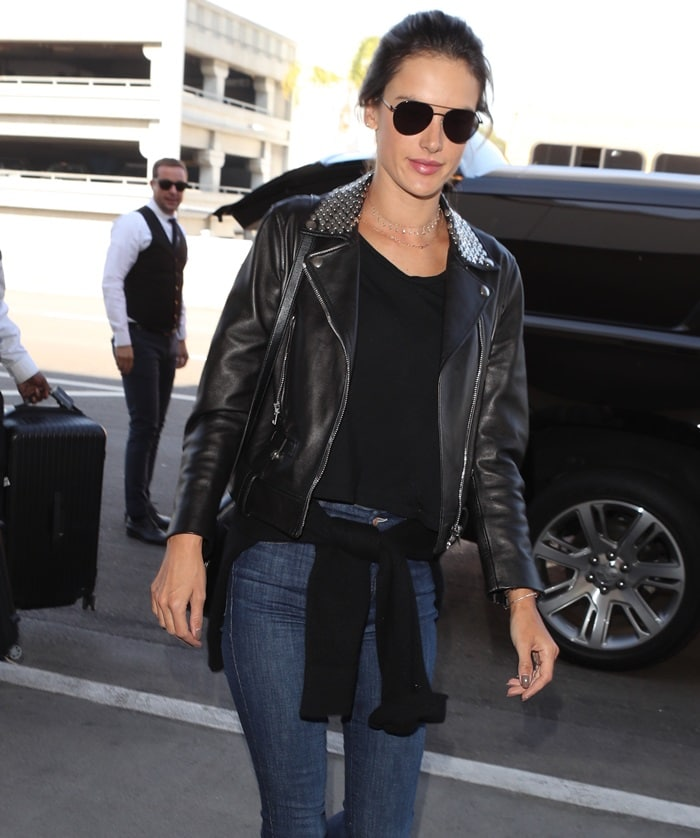 Alessandra Ambrosio wearing a leather motorcycle jacket with metal studs by Nour Hammour while jetting out of Los Angeles International Airport on February 2, 2018