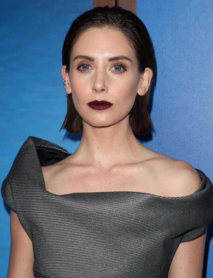 Alison Brie a gray off-the-shoulder Vivienne Westwood dress at the 2018 Writers Guild Awards at The Beverly Hilton Hotel in Beverly Hills, California, on February 11, 2018